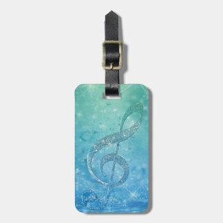 Clef agudo azul del efecto brillante reluciente he etiqueta para equipaje