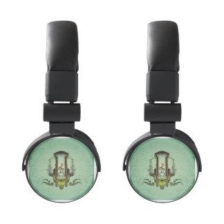 Clef en el botón decorativo auriculares