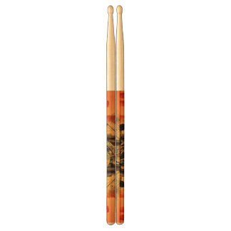 Clef on a decorative button drumsticks