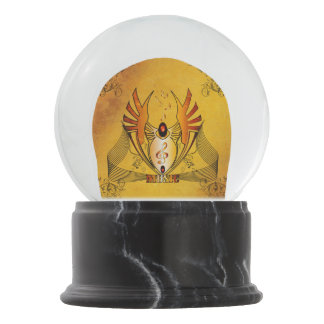 Clef on a decorative button snow globe