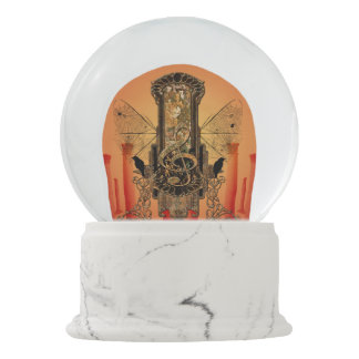 Clef on a decorative button with birds snow globe