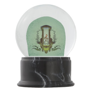 Clef on decorative button with roses snow globe