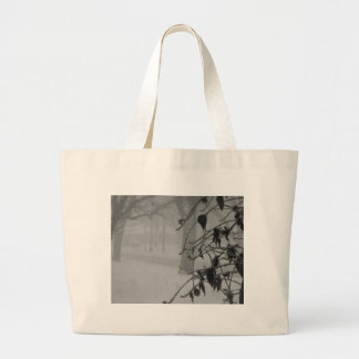 Clematis and Snow fall during a blizzard. Large Tote Bag
