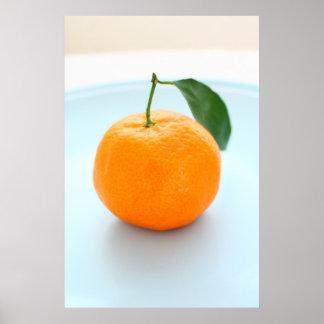 Clementinas anaranjadas y un cuenco azul impresiones