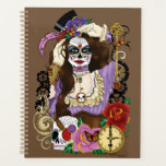 "Clementine Planner<br><div class=""desc"">Steampunk day of the dead woman wearing sugar skull make-up. Dressed mostly in purple. Around her are gears,  skull,  clock,  roses,  and keys.</div>"