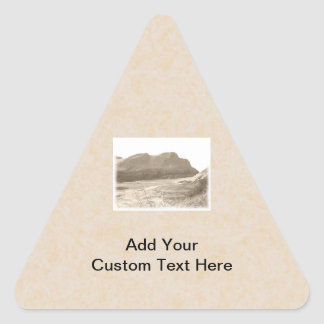Cliffs in sepia color. On beige background. Triangle Sticker