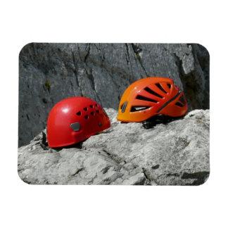 Climbing Helmets on a Rock Magnet Vinyl Magnet