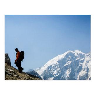Climbing up a mountain postcard