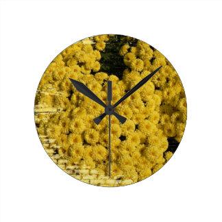 Clock flowers on bricks yellow