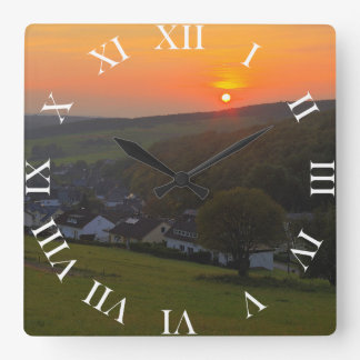 Clock sunset in the low mountain range