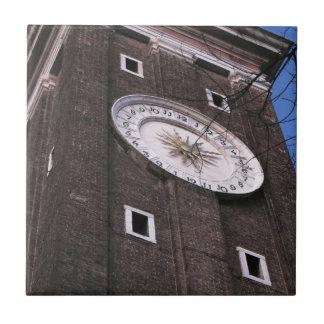 Clock tower at Santi Apostoli church in Venice Tile