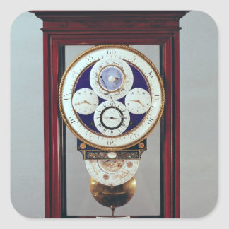 Clock with four dials and the signs of the square sticker