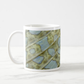 Close look at the caudal fin of a peacock flounder coffee mug