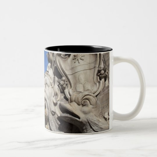 Close-up detail of a face and fish on the Two-Tone coffee mug
