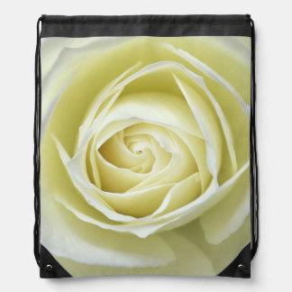 Close up details of white rose cinch bag