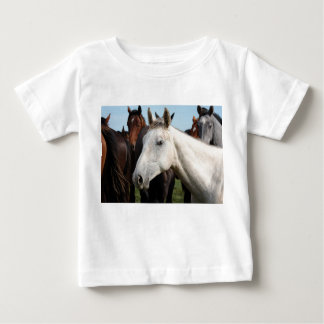 Close-up herd of horses. baby T-Shirt