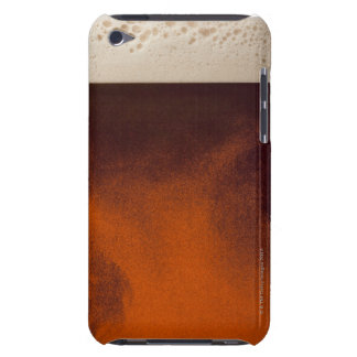 Close up image of amber colored beer with frothy barely there iPod case