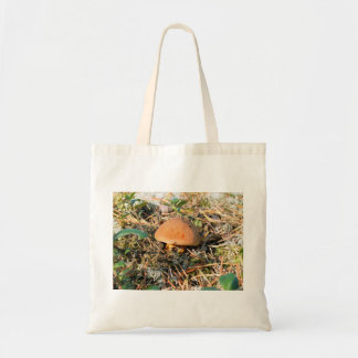close up mushroom in a forest tote bag