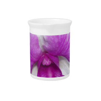 close up of a beautiful purple and white orchid beverage pitcher