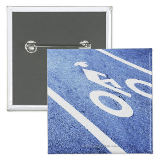 Close-up of a bicycle sign on the road pin