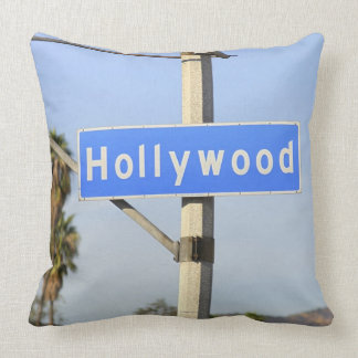Close-up of a blue street sign on a lamppost throw pillows