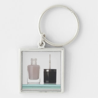 Close-up of a bottle of nail polish key chain
