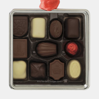 close-up of a box of assorted chocolates square metal christmas ornament