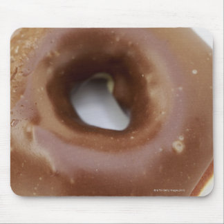 Close-up of a chocolate doughnut on a plate mouse pad