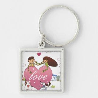 Close-up of a couple holding a heart shape keychain