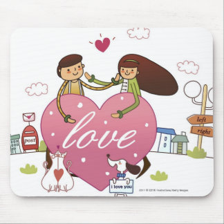 Close-up of a couple holding a heart shape mouse pad