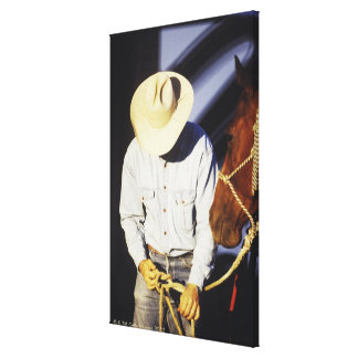 Close-up of a cowboy tying a rein canvas print