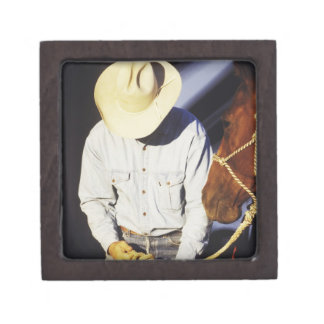 Close-up of a cowboy tying a rein gift box