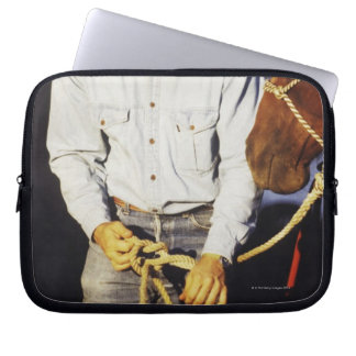 Close-up of a cowboy tying a rein laptop computer sleeves