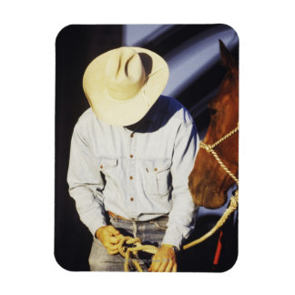 Close-up of a cowboy tying a rein magnet