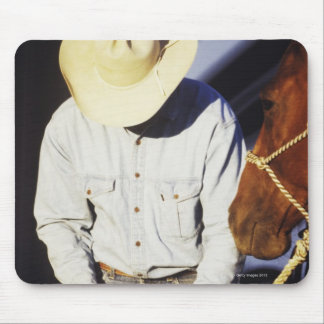 Close-up of a cowboy tying a rein mouse pad