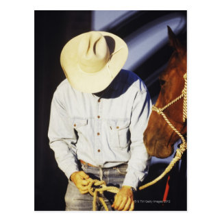 Close-up of a cowboy tying a rein postcards