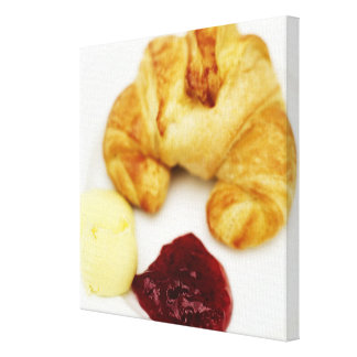 Close-up of a croissant served with butter and canvas print