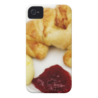 Close-up of a croissant served with butter and iPhone 4 cover