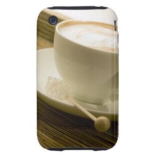Close-up of a cup of coffee with a candy tough iPhone 3 case