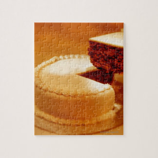 close-up of a cut piece of cake being taken out jigsaw puzzle