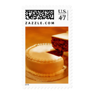 close-up of a cut piece of cake being taken out postage