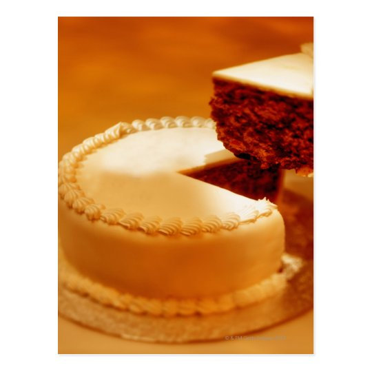 close-up of a cut piece of cake being taken out postcard