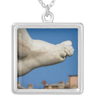 close-up of a foot on the Fontana dei Quatro Silver Plated Necklace