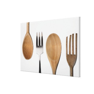 Close-up of a fork with a wooden spoon canvas print