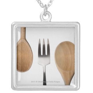 Close-up of a fork with a wooden spoon personalized necklace
