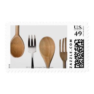 Close-up of a fork with a wooden spoon postage stamp