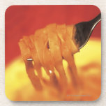 close-up of a forkful of pasta coasters