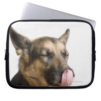 Close-up of a German Shepherd licking its nose Laptop Sleeve