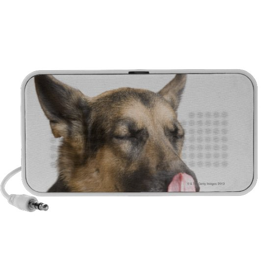 Close-up of a German Shepherd licking its nose Portable Speaker