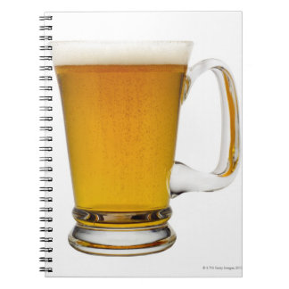 Close up of a glass of beer 2 notebooks